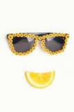 Flower sunglasses with lemon lips. Flower sunglasses with lemon smile. like a funny face royalty free stock images
