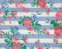 Flower Table Cloth. Table cloth with stripes and roses pattern in blue, red, pink and white Stock Images