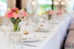 Flower table decorations for holidays and wedding dinner. Table set for holiday, event, party or wedding reception in Stock Photography
