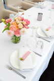 Flower table decorations for holidays and wedding dinner. Table set for holiday, event, party or wedding reception in Royalty Free Stock Image