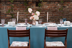 Flower table decorations for holidays and wedding dinner. Table set for holiday, event, party or wedding reception in Stock Image