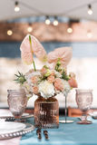 Flower table decorations for holidays and wedding dinner. Table set for holiday, event, party or wedding reception in Royalty Free Stock Photo