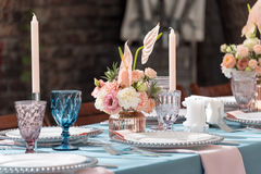 Flower table decorations for holidays and wedding dinner. Table set for holiday, event, party or wedding reception in Stock Photo