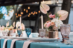 Flower table decorations for holidays and wedding dinner. Table set for holiday, event, party or wedding reception in Stock Images