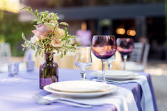 Flower table decorations for holidays and wedding dinner. Table set for holiday, event, party or wedding reception in. Outdoor restaurant stock photos