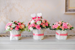 Flower table decorations for a wedding party. The bouquets from pink and white roses. Close-up Royalty Free Stock Images
