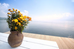 Flower table on wooden pier Stock Photos