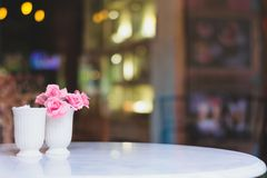 Flower with tables in coffee shop , bokeh background royalty free stock photos