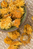 Flower Tea. Chinese yellow flower tea ingredient on a mat Royalty Free Stock Photo