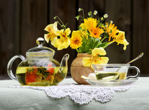 Flower tea. Still-life with flower tea and a bouquet Royalty Free Stock Photo