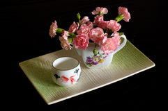 Flower and Tea. Chinese tea and flower pot Royalty Free Stock Photography