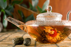 Flower tea. Glass teapot with blooming tea Stock Images