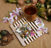 Flower tea. To a support with a mug of ready tea Stock Photos