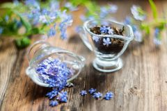 Free Flower Tea And A Bouquet Of Forget-me-nots On A Wooden Background Royalty Free Stock Photos - 99971198