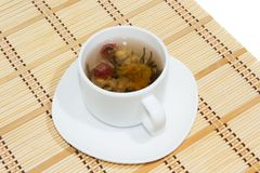 Flower tea. Chinese lotus flower tea in the cup royalty free stock photos