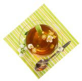 Flower tea in cup with saucer, napkin Stock Image