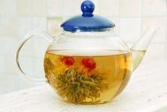 Flower tea in glass pot Royalty Free Stock Photos