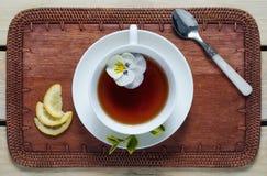 Flower tea with lemon wedges. Royalty Free Stock Image