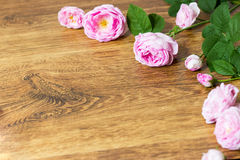 Flower tea rose buds on old wooden table Stock Photo