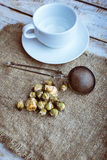 Flower tea rose buds with with tea infuser Royalty Free Stock Image