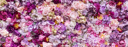 Flower texture background for wedding scene. Roses, peonies and hydrangeas, artificial flowers on the wall. Banner fow