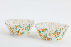 Flower-Themed Cup Cake Papers Royalty Free Stock Photos
