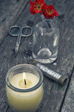 Flower,threads and burning candle Royalty Free Stock Photos