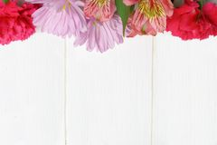 Flower top border on white wood Royalty Free Stock Images
