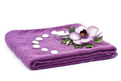 Flower and towel Royalty Free Stock Image