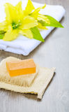 Flower on towel and soap on bast Royalty Free Stock Photo
