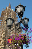 Flower tower. Tower behid a lamp with flower Royalty Free Stock Photos