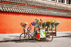 Flower trade stand. Flower trade stand by the exterior of the monastery at sunny day time Royalty Free Stock Photo