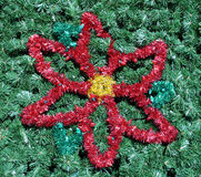 Flower in Tree. A red flower in a green christmas tree Stock Photos
