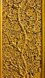 Flower and tree carving. Motif of flower, Phrathat Hari Phunchai Temple, Lamphun, Thailand royalty free stock photos