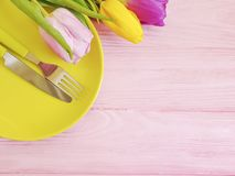 Flower tulip blooming , a plate dinner on a pink wooden romantic background, birthday. Flower tulip, a plate on a pink wooden background birthday romantic dinner stock images
