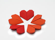 Flower of Valentine's heart shaped folded papers. Isolated on white background Stock Images