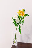 Flower in the vase. White and yellow alstroemeria flowers in the vase on the table Stock Photo