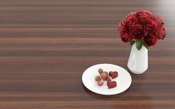 Flower in the vase with dessert on a plate - right view Royalty Free Stock Photography