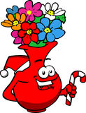 Flower vase holding a candy cane and wearing Santa's hat Royalty Free Stock Photo