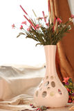 Flower in vase on the table. A vase of freshly flowers sitting in front of a screened window royalty free stock photos