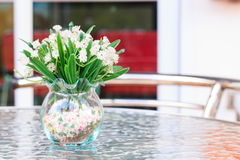 Flower in vase on table. White flowers in vase on table Royalty Free Stock Image