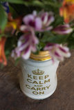 Flower vase with text `Keep calm and carry on ` Stock Images