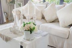 Flower in vase on white table in living room Stock Photography