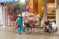 Flower vendors on the streets of Hanoi, Vietnam. Hanoi, Vietnam - 3 MARCH: Flower vendors on the streets of Hanoi, March 3, 2014 royalty free stock photos