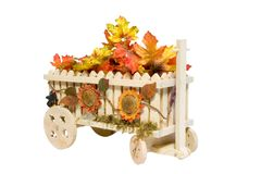 The Flower Wagon. A wooden hand made wagon with leaves & flowers on white background Royalty Free Stock Image