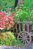 Flower wagon in garden. Flower wagon with cross on top Royalty Free Stock Images