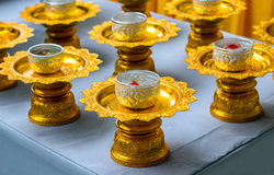Flower and water for song-gran day festival. Cool water in silver bowl and gold plate thai style pattern Stock Photos