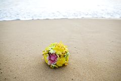 Flower wedding bouquet on tropical beach Royalty Free Stock Image