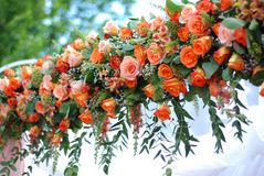 Flower Wedding Bouquets or Garland for wedding Arc, including Orange Roses and Chrysanthemums, orange gerberas and Yellow Margueri royalty free stock image