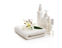 Flower white Lily lying on a towel. And bottles Stock Photos